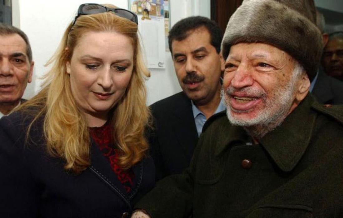 عرفات وزوجته سهى.