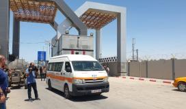 اسعاف ينقل جرحى العدوان على غزة.jpg
