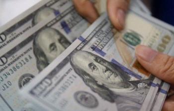 الدولار الامريكي في فلسطين.jpg