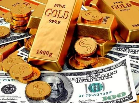 الدولار والذهب.jpg